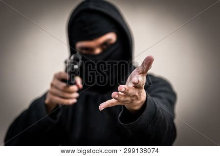 A Man Holding A Gun In Hand, The Ship Ready To Shoot The Man Pointed A Gun At Us. A Man Holding A Gu