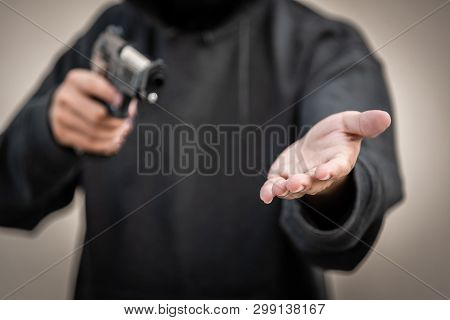 Gun And Money In A Hands. Bank Robbery, Man Carrying A Gun To Rob The Money. To Threaten With The Gu