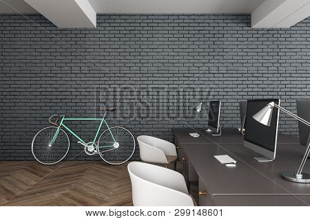 Modern Coworking Hipster Office Interior With Desktops, Computers And Bicycles On Brick Wall Backgro