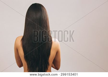 Young Woman With Long Black Hair Posing On Camera. Showing Lenght Of It. Smooth Treasure. Standing B