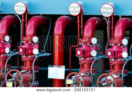 Main Supply Water Piping In The Fire Extinguishing System. Fire Sprinkler System With Red Pipes. Fir