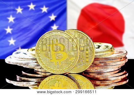Bitcoins On The Background Of The Flag European Union And Japan. Concept For Investors In Cryptocurr