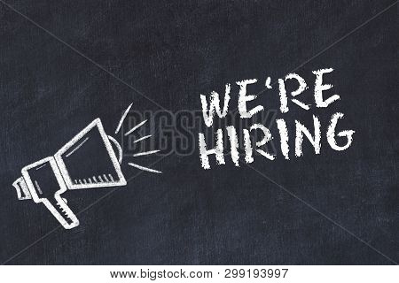 Chalk board sketch with loudspeaker and phrase were hiring. poster