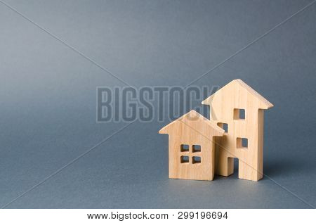 Wooden Houses Figures. Environmentally Friendly And Environmentally Friendly Home. Modern Technology