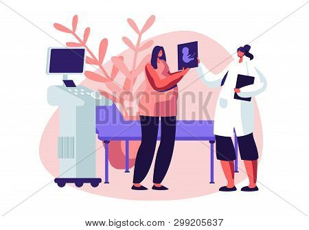 Pregnant Woman In Ultrasound Cabinet Watching Baby Picture. Female Character Doctor Show Fetus Image