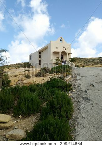 Hillside Church Overlooking The Inland Lake At Dwejra, On The Island Of Gozo, Malta.