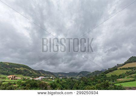Dramatic Clouds Over Fazenda De Santa Cruz In Flores, Azores.