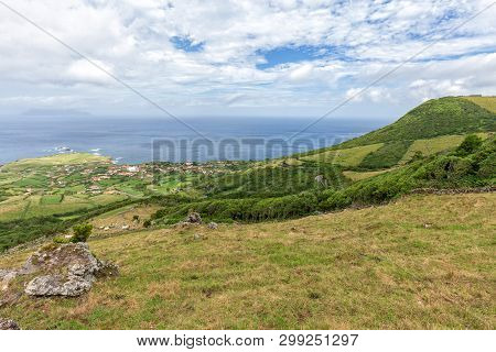 Corvo Island Stands In The Distance Near Ponta Delgada On The Island Of Flores In The Azores.