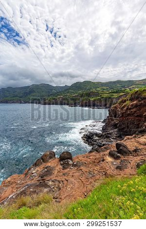 Portrait View Of The Volcanic Cliffs Below Ponta Delgada On The Island Of Flores In The Azores.