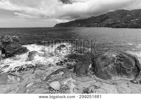 Waves Crash Among Rocks On The Shoreline Below Ponta Delgada On The Island Of Flores In The Azores.
