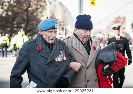 Ottawa, Canada - November 11, 2018: Two Canadian Army War Veteran, Senior Men, With Their Medals And
