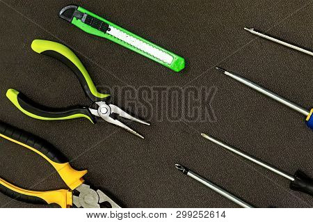 row of tools rubber nippers green knife building metal screwdriver pattern building poster