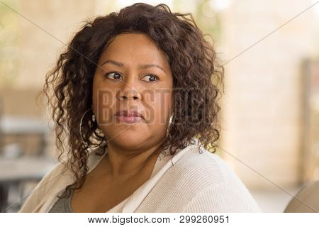African American Middle Age Woman Looking Sad.
