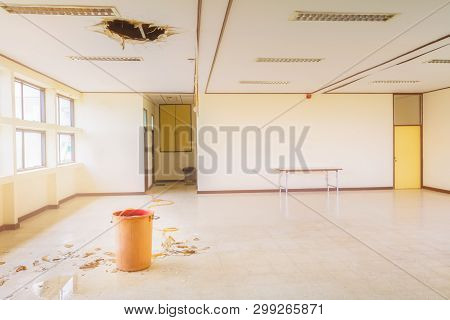 Water Leak Drop In Red Tank Interior Office Building In From Ceiling And Flow On Terrazzo Floor
