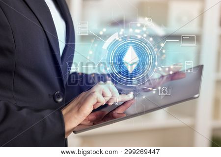 Business woman using tablet in home office mood with cryptocurrency bitcoin link network concept
