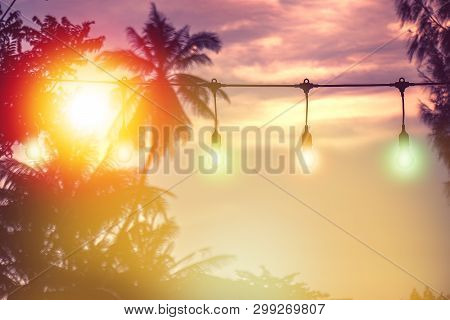 Blurred Light With Coconut Palm Tree Background On Sunset, Yellow String Lights Decor In Outdoor Res