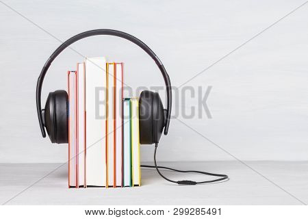 Group Of Books With The Earphones. Audiobooks. Listen And Study Concept.