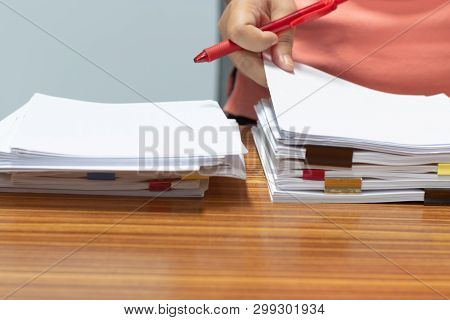 Teacher Hand Searching Report Papers And Students Homework Assignment For Checking Score. Pile Of Un