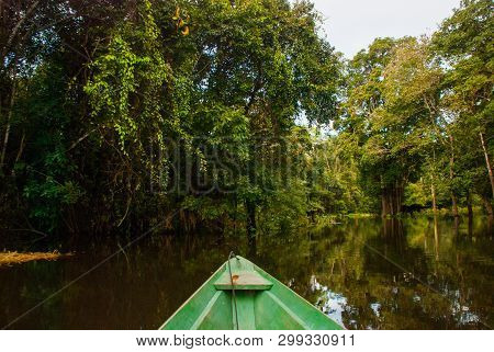 Amazon River, Manaus, Amazonas, Brazil: Wooden Boat Floating On The Amazon River In The Backwaters O