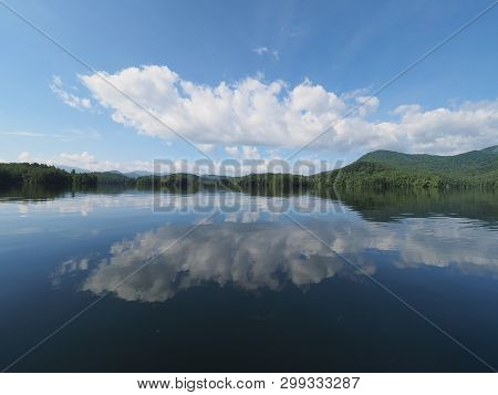 Beautiful Summer Cloudscape Reflected On The Tranquil Waters Of Lake Santeetlah, North Carolina,