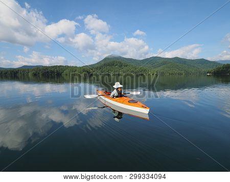 Lake Santeetlah, North Carolina June 6, 2018 Woman Kayaks On Lake Santeetlah, North Carolina, On A T