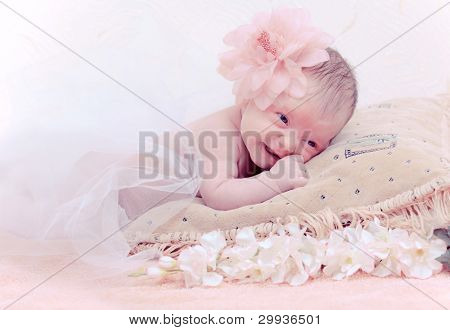 Close up portrait newborn baby lying in pillow