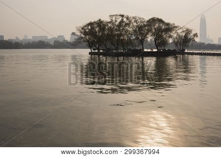 Peninsula On A Lake In Jinan Park On A Sunny Winter Evening, China
