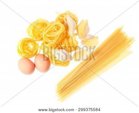 Raw Dry Tagliatelle Noodle, Conchiglioni, Italian Pasta, Eggs Isolated On White Background