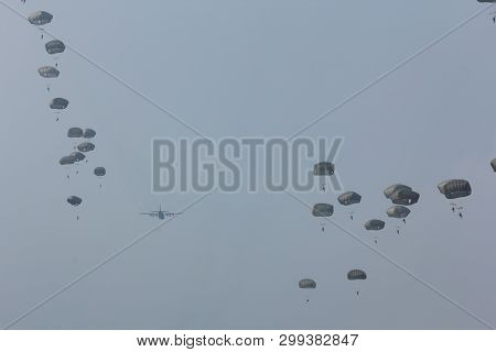 Ede, The Netherlands - September 20 2014:  Paratroopers Jumping From A C-130 Hercules  Aircraft Over
