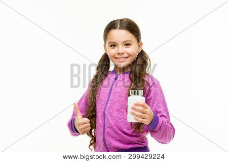 Maintaining Good Health. Little Child Gesturing Thumbs Up To Pill Bottle. Small Girl With Medicine P