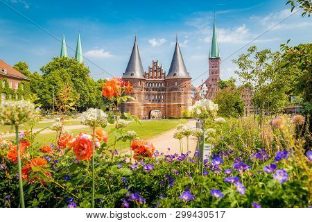 Classic Postcard View Of The Historic Town Of Lübeck With Famous Holstentor Gate In Summer, Schleswi
