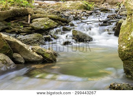 Nature Background Of Water Flowing Over Rocks In An Appalachian Stream.