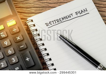 Retirement Plan Concept, Calculator With Empty Notepad With Pen And Handwriting Headline As Retireme