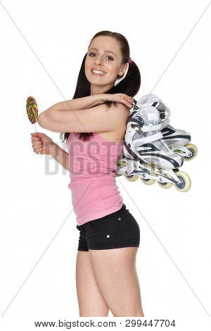 Young  sporty woman with rollerskates and lollipop  on a white background.