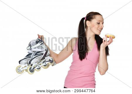 Young  sporty woman with rollerskates and donut  on a white background. Choice problem.