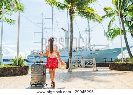 Cruise travel passenger going on board embarking ship with luggage suitcase. Woman tourist on Tahiti French Polynesia summer vacation.