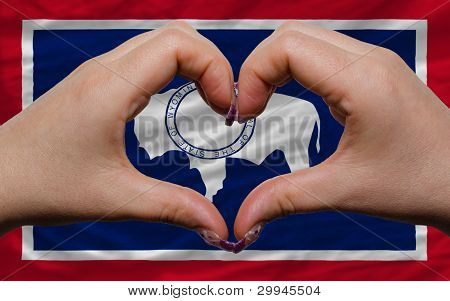 Over American State Flag Of Wyoming Showed Heart And Love Gesture Made By Hands