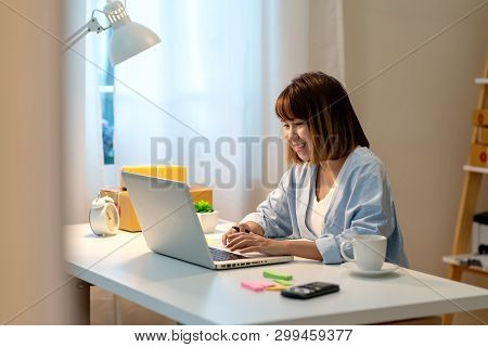 Candid Of Happy Young Attractive Asian Woman Work At Home In Evening Or Late Night With Sme Business