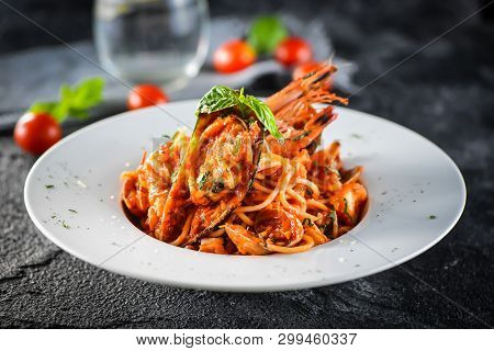 Seafood Lobster Spaghetti In A White Ceramic Dish