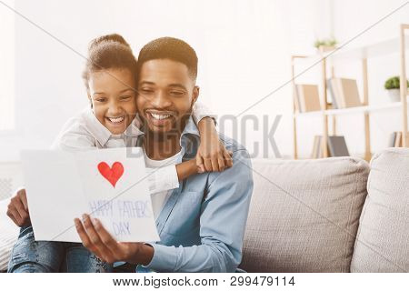 Happy Fathers Day. Daughter Congratulating Dad And Giving Him Postcard, Free Space
