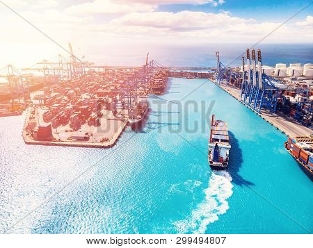 Cargo Port Business, Logistics Center. Ship Is Loading Containers With Crane. Aerial View.