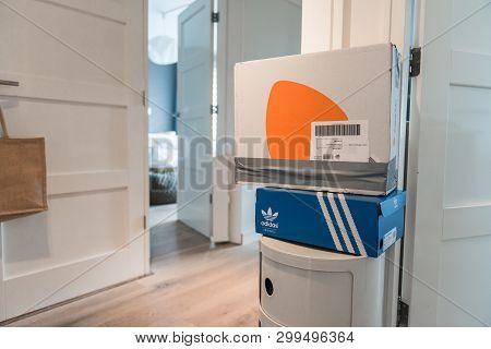 Amsterdam, Jisperveldstraat, The Netherlands, 05/04/2019. Zalando Package Is Waiting In The Hall To