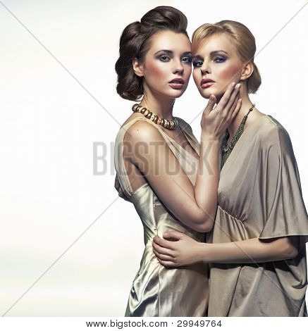 Two elegance ladies hugging