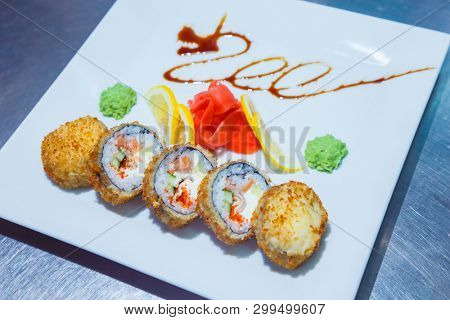 sushi rolls on white plate. food