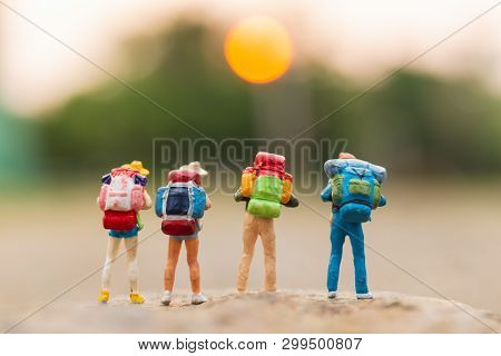 Miniature People : Traveler With Backpack Walking On The Rock