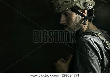 Numb To The Feelings. Close Up Profile Portrait Of Young Male Soldier. Man In Military Uniform On Th