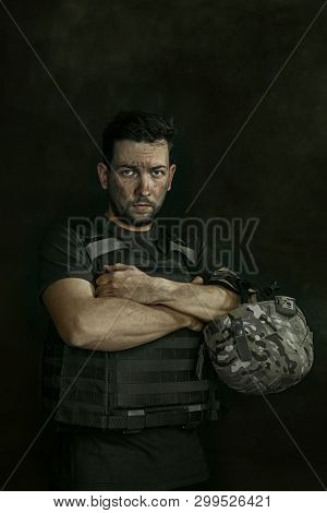 Strenght Inside Is Melting. Close Up Portrait Of Young Male Soldier. Man In Military Uniform On The