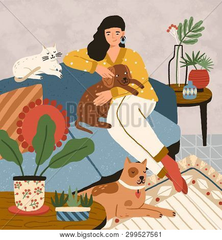 Cute Smiling Young Girl Sitting On Comfy Sofa With Dogs And Cat. Adorable Woman Spending Time At Hom