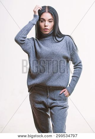 Knitwear concept. Feel warm and comfortable. Woman wear grey textile suit blouse and pants. Warm comfortable clothes. Casual style fashion for every day. Female knitwear. Fashionable knitwear poster