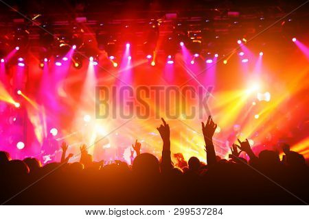 People With Their Hands Up At A Concert Of Their Favorite Group